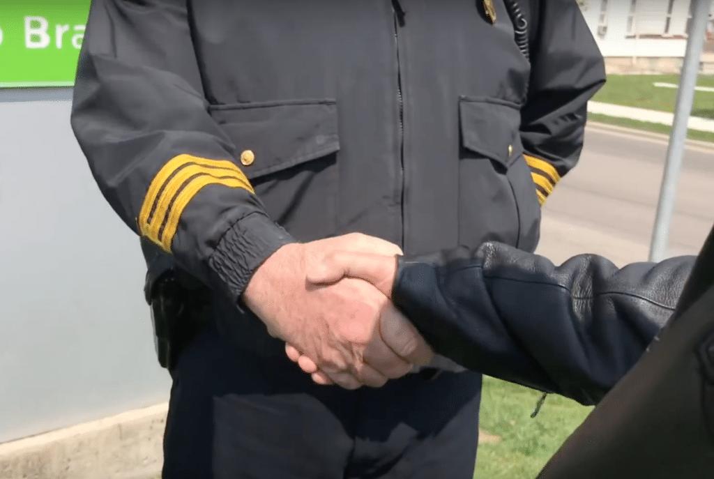 Police shake Bill's hand