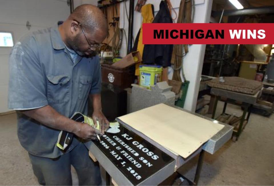 The headstone via Detroit News