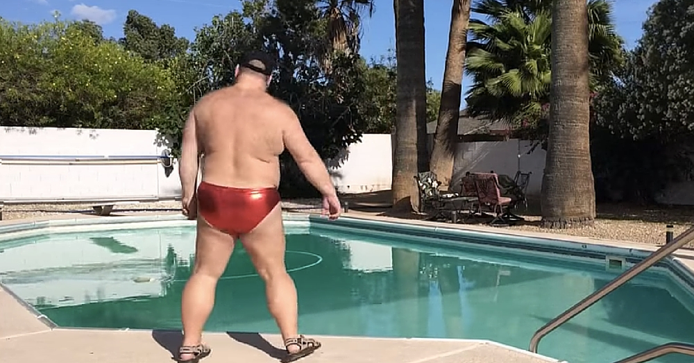 Man Stands By Pool In Shiny Red Speedo. When The Music Starts…I Can't Stop Laughing