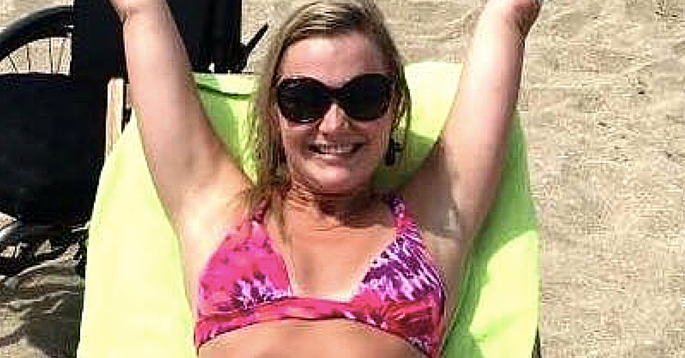 Woman Poses In Bikini While On Vacation. But Then The Camera Pans Out..