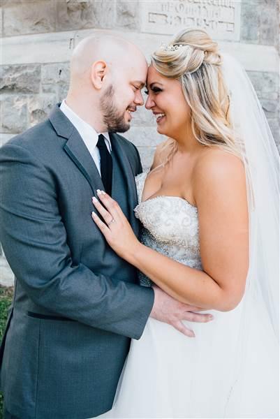 The happy couple: Daniel Benton and his bride, Christina Torino-Benton. Lana Nimmons Photography