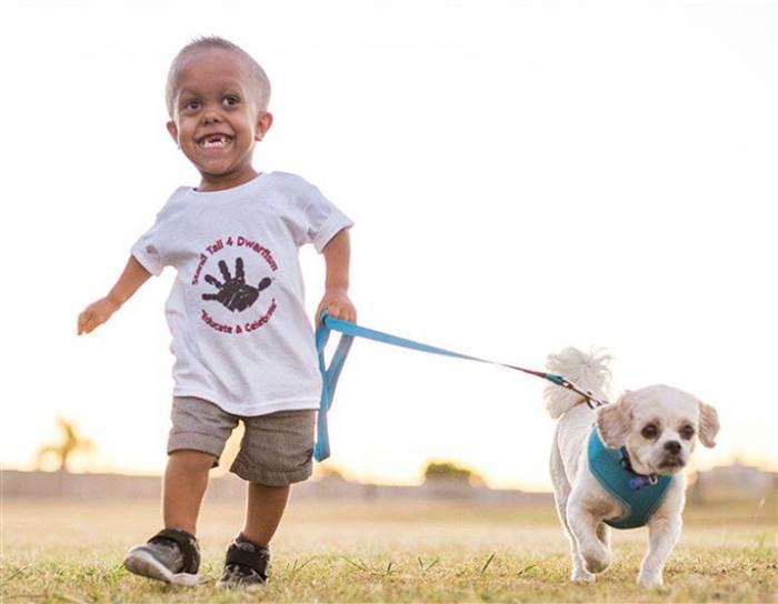 Courtesy of Yarraka Bayles. Quaden taking Buddy for a walk
