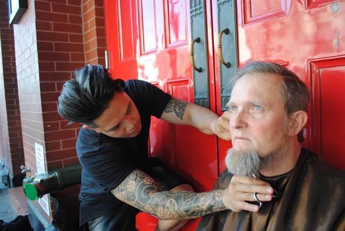 Bustos cut Thomas' hair on the streets of New York City. Courtesy of Alexandra Zaslow