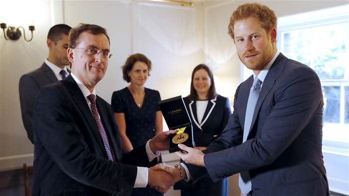 Prince Harry after presenting a 2016 Invictus Gold medal to members of Britain's Papworth Hospital. The medal was earned by U.S. Staff Sgt. Elizabeth Mark, who wanted to thank the hospital for saving her life.