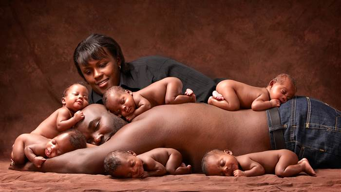 The McGhee family portrait taken in 2010, shortly after the sextuplets were born. Janine and Brian Killian/Peters Photography / Janine and Brian Killian/Peters Photography