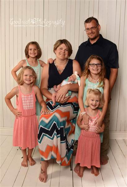 Kenny Frey, his wife Holly, and their five daughters. Rosanne Goodrich