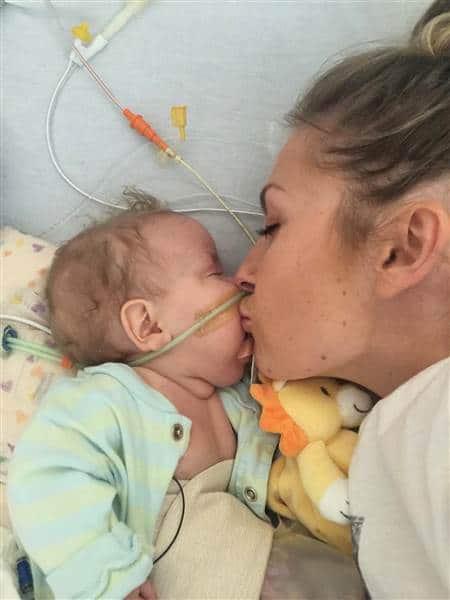 Demi Frandsen kisses her son Leo, who spent 10 months in the NICU. Courtesy of The Frandsen Family