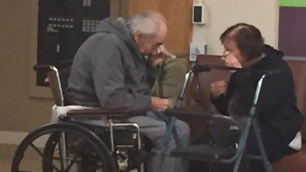 Ashley Bartyik snapped this photo of her grandparents as they met for a visit at a transition house. The couple has been separated for eight months. (Facebook/Ashley Bartyik)