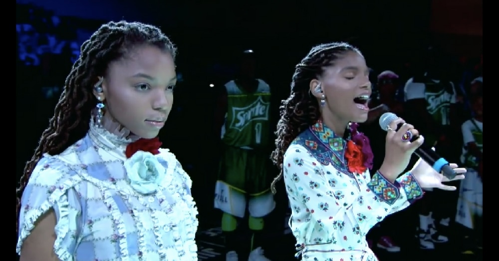 2 Sisters Stand To Sing National Anthem, But Wait Till The One On The Left Opens Her Mouth