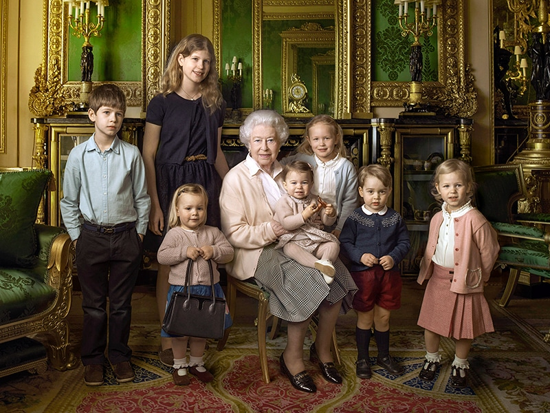 This official photograph, released by Buckingham Palace to mark her 90th birthday, shows Queen Elizabeth II with her five great-grandchildren and her two youngest grandchildren. ANNIE LEIBOVITZ