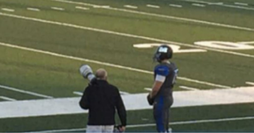 Football Team Refuses To Come On Field For Anthem. Then Mom Spots 1 Player Standing Alone On Sidelines