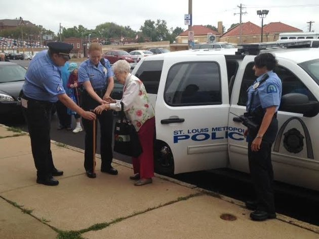 Edie Simms is seen being helped out of a police car following a fun-filled ride on Friday. ST LOUIS METROPOLITAN POLICE