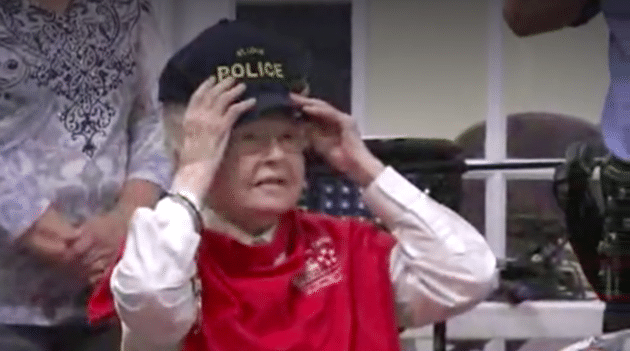 The do-gooder is seen trying on a St Louis Police Department hat after handing out handmade gifts to some of the senior center's guests. KPLR