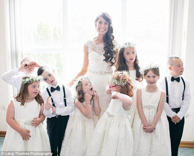 All together: A special education teacher in Louisville, Kentucky, has touched hearts across the country after inviting her students along to her wedding. Lang Thomas Photography