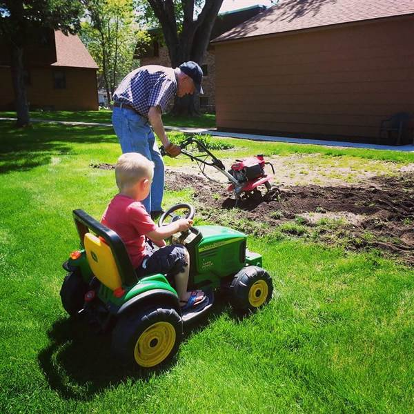 Emmett supervised as Erling attended his garden. Courtesy of Anika Rychner