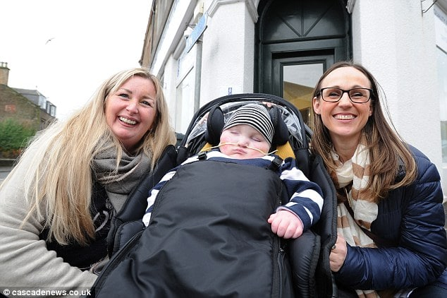 Lottery winner Gillian Bayford (left) is buying a property and paying for adaptations to a home for Jenny McMillan and her severely-disabled son Blake