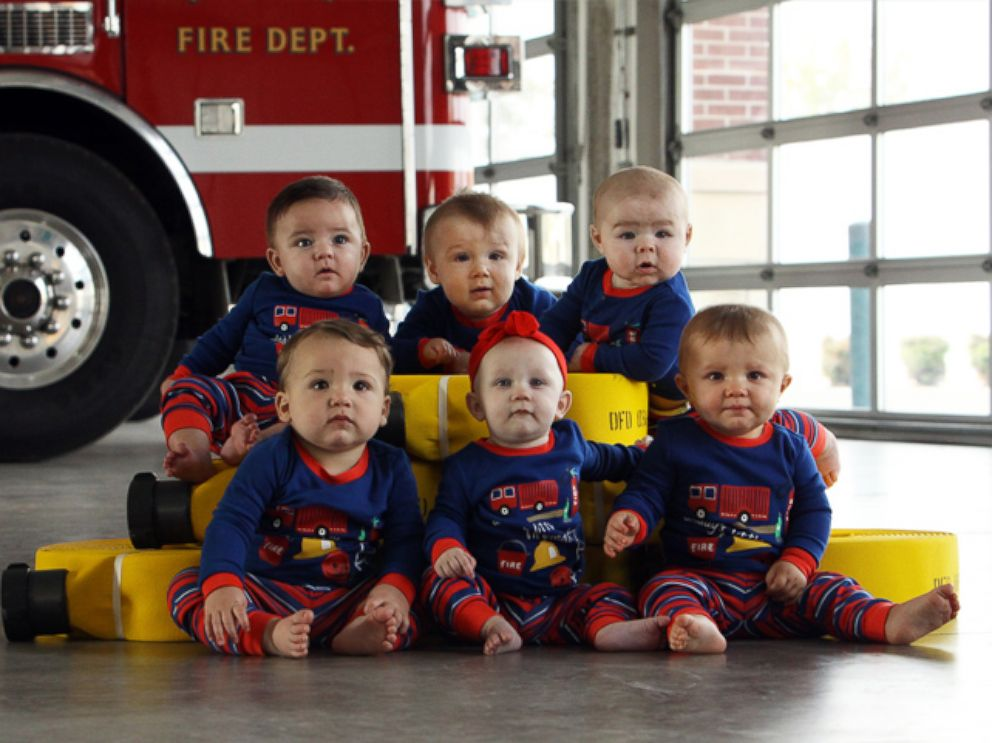 Six babies born to firefighters in Oklahoma pose for adorable fire station Christmas card. Richard Parker / Durant Fire Department