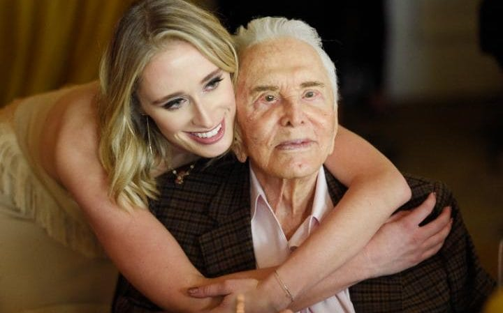 Kirk Douglas is embraced by his granddaughter Kelsey CREDIT: CHRIS PIZZELLO/INVISION/AP