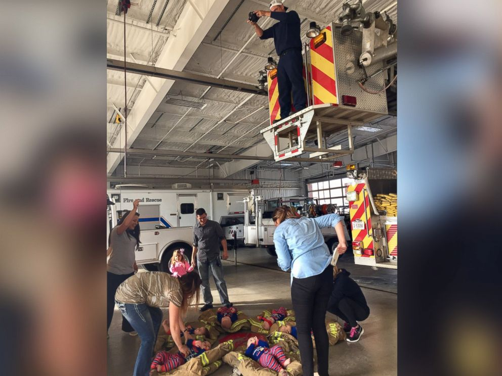 Six babies born to firefighters in Oklahoma are photographed for the fire station's Christmas card. Courtesy Dana Joines