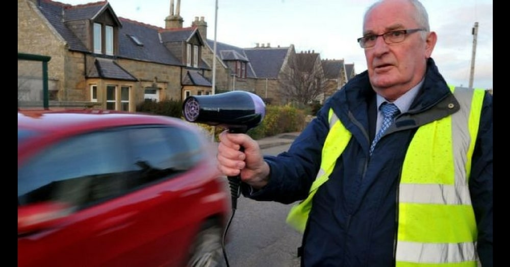 Elderly Man Stands On Road With Hair Dryer. When I Saw Why… Brilliant!