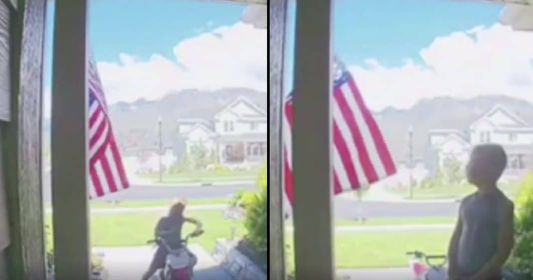 She's Confused When Boy Stops At Her House, But She Immediately Knows Why When She Sees What He Does With Flag