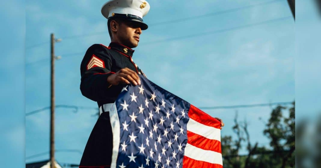 Marine With PTSD Steps Up To Ledge Over Busy Highway. Then He Unfurls American Flag