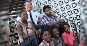 APD Deputy Chief Jeff Glazier with Rhodes family