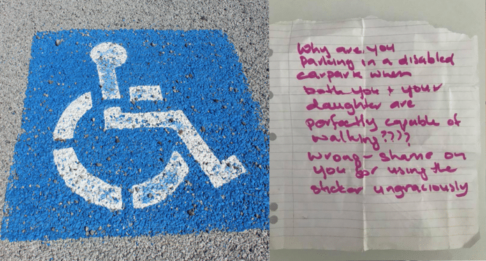 Handicapped parking sign and handwritten note