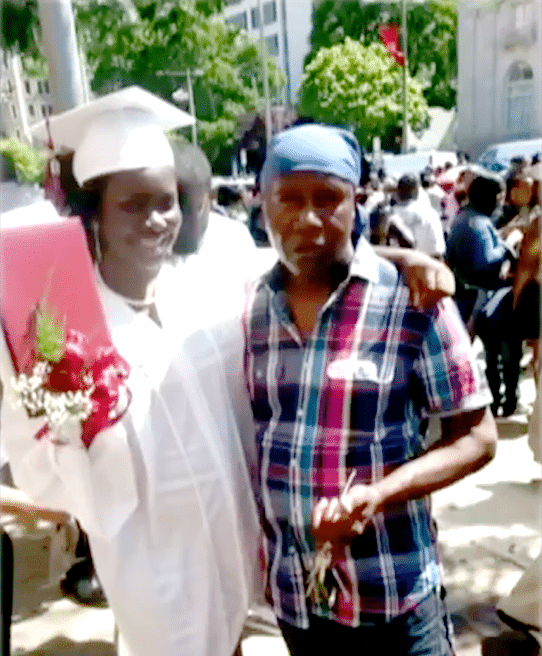 Frederick Waring and his daughter on graduation day