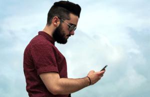 man reading phone