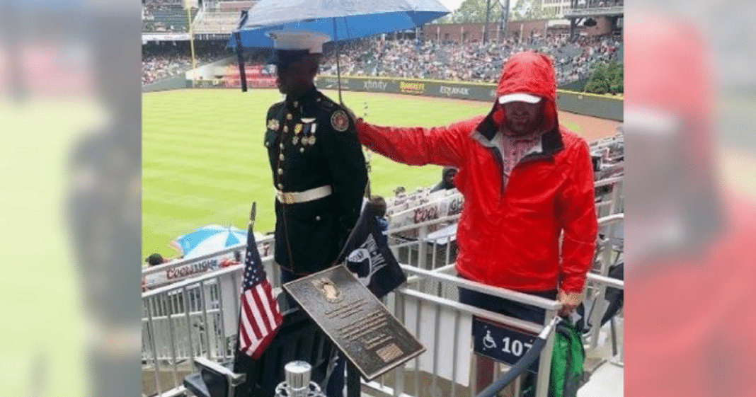Powerful Image Shows Baseball Fan Holding Umbrella Over Marine Corps JROTC Member