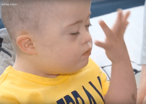 """Wyatt gives the sign for """"beautiful,"""" which is one of his favorites."""