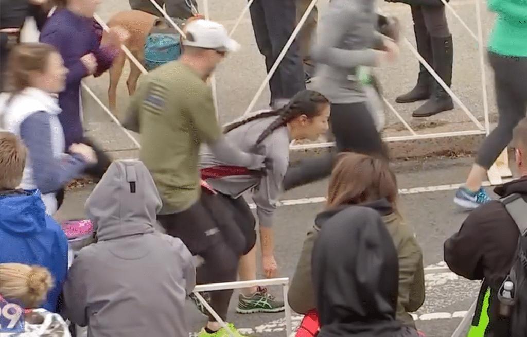Haley Klinger stumbles as she nears the finish line