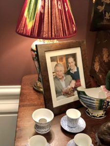 Prince William and Prince Charles hold baby George in a display.