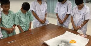 The kids bow their heads for Saman Kunan.