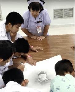 The kids draw the fallen hero.