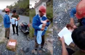 The men try to comfort the baby as they wait for police