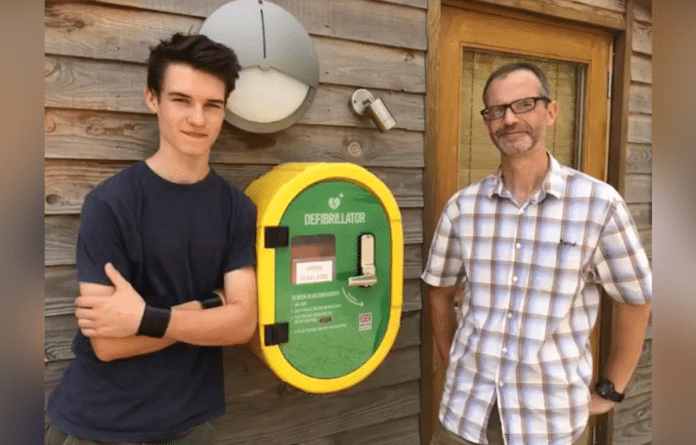 Stuart and Ethan Askew with the defibrillator