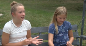 The girls bravely tell the news crew what happened
