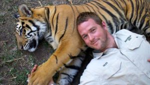 Giles Clark and one of the tigers in his care