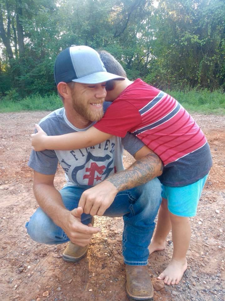 Dillon Moore's son hugs him when he sees his father's new smile