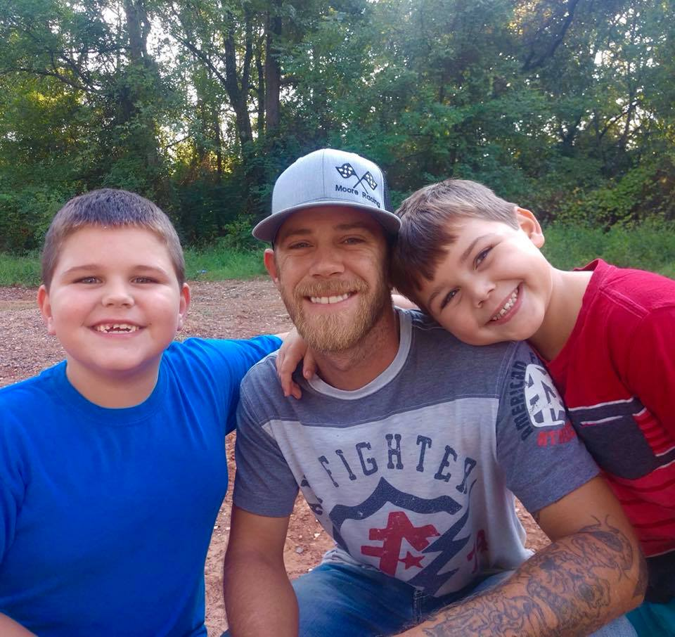 Dillon Moore's sons share a smile with Dad via Facebook