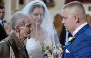 The groom shakes Karwowski's hand as he gives away the bride