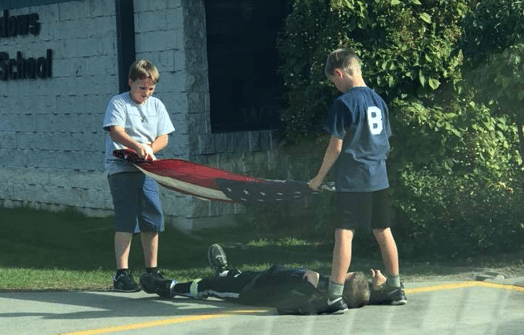 Photo Of Three 5th-Grade Boys' Careful Treatment Of American Flag Goes Viral