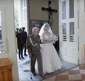 Major Bronislaw 'Grom' Karwowski accompanies Joanna into the church accompanied by the Armed Forces