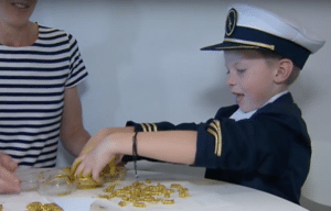 Gavin hard at work making his now famous macaroni necklaces.