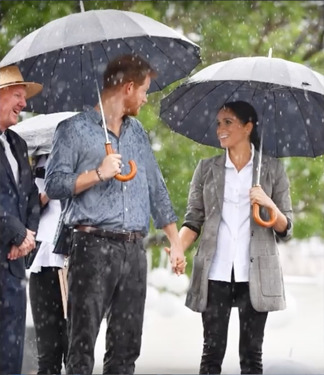 Prince Harry and Meghan Markle walking in the rain together