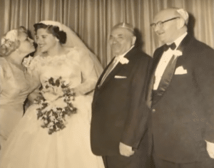 Joanne Lowenstern on her wedding day with the parents who adopted her