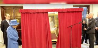 Queen Elizabeth II as portrait is unveiled at RAF Club