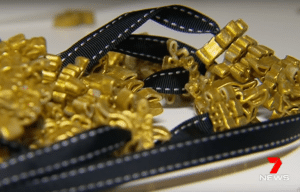 The gold-painted macaroni necklaces